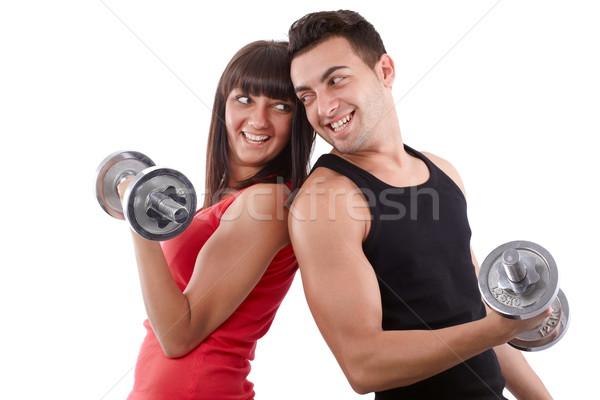 Képzés együtt fiatalember nő csapat súlyzók Stock fotó © georgemuresan