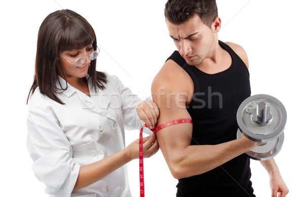 тренировки довольно молодые медсестры бицепс Сток-фото © georgemuresan