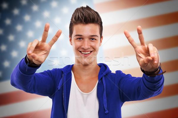 Młody człowiek portret przystojny zwycięstwo Zdjęcia stock © georgemuresan