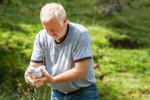 男 独自の 洗濯 自然 歳の男性 ストックフォト © georgemuresan