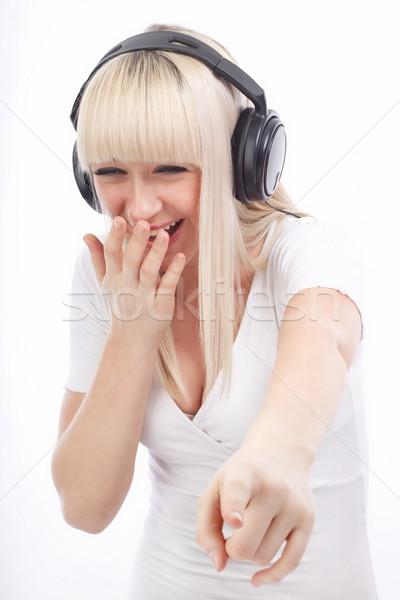 Nevet valami portré nő hallgat zene Stock fotó © georgemuresan