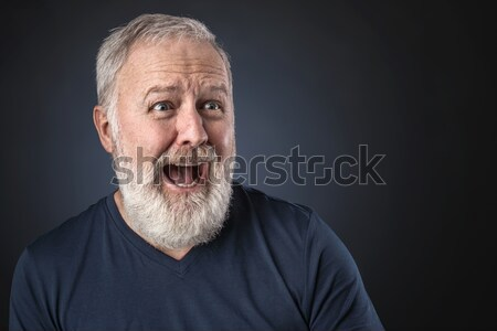 Scared senior looking a way Stock photo © georgemuresan