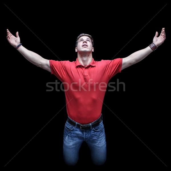 Jovem moço posição as mãos levantadas Foto stock © georgemuresan