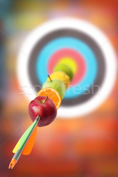 Jó lövés gyümölcsök nyíl cél vitaminok Stock fotó © georgemuresan