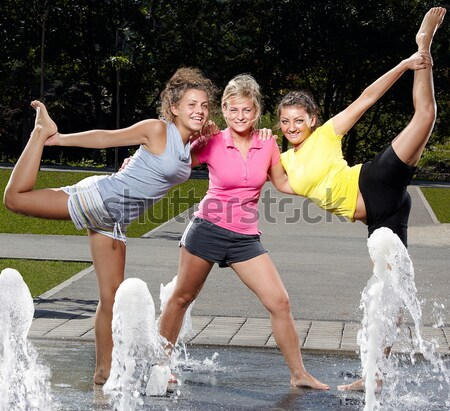 Jumping in a fountain Stock photo © georgemuresan