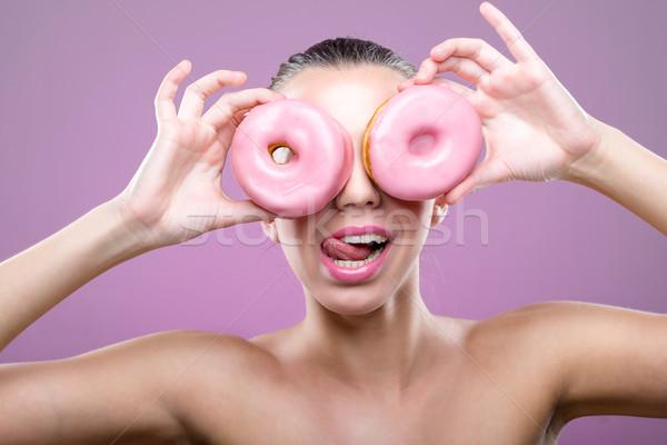 Piękna kobieta dwa oczy różowy pączek Zdjęcia stock © Geribody