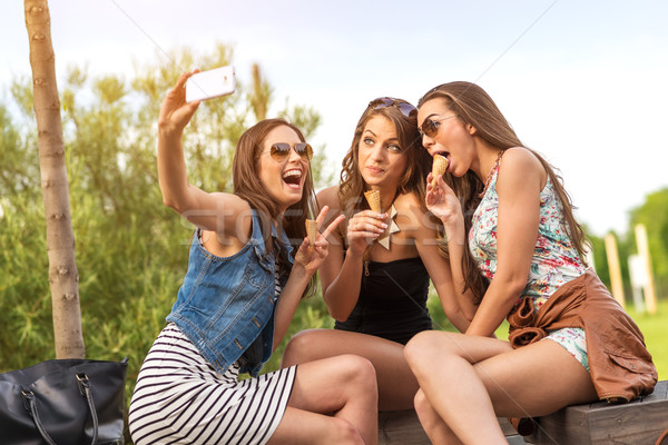 3 beautiful girlfriend eating ice cream while Selfie photo Stock photo © Geribody