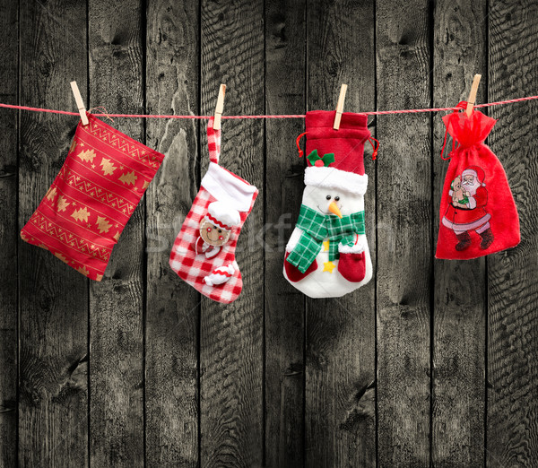 Santa's bag on the clothesline, with wood background Stock photo © Geribody