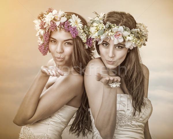 Two beautiful spring fairy , brides sending a kiss to you Stock photo © Geribody