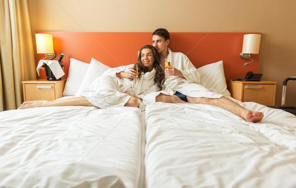 кровать номер в отеле человека пару комнату Сток-фото © Geribody