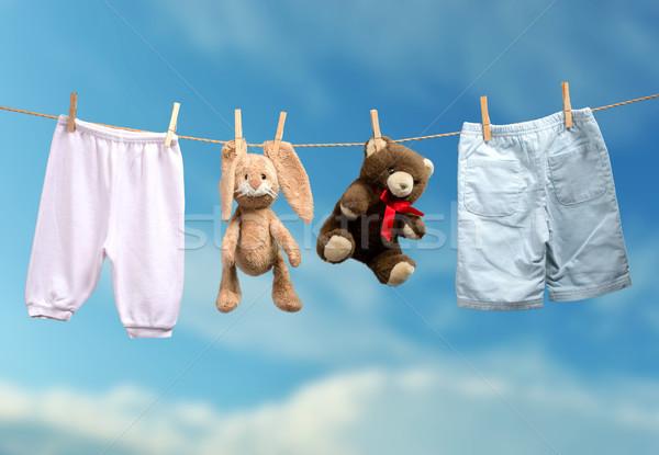 Boy or girl? on the outdoor clothesline Stock photo © Geribody
