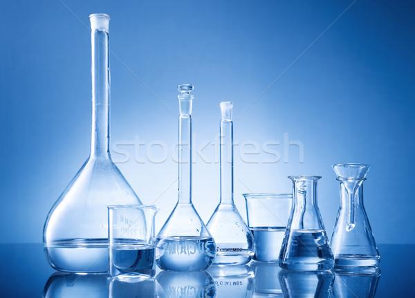 Laboratory equipment, bottles, flasks on blue background Stock photo © Geribody