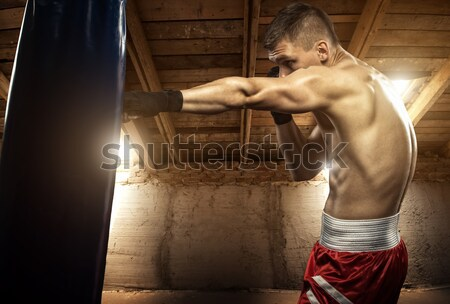 Young woman boxing workout on the attic  Stock photo © Geribody