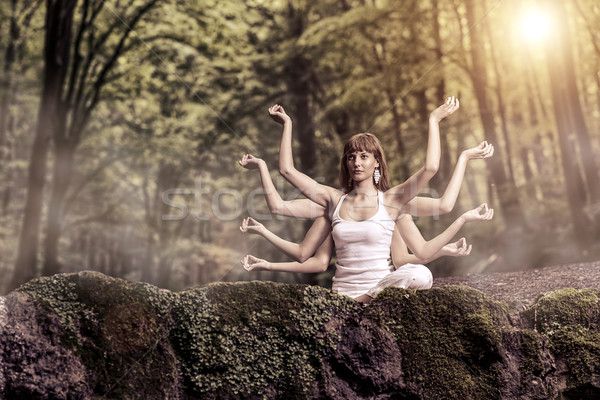 Eight arm woman sitting on a forest and pray Stock photo © Geribody