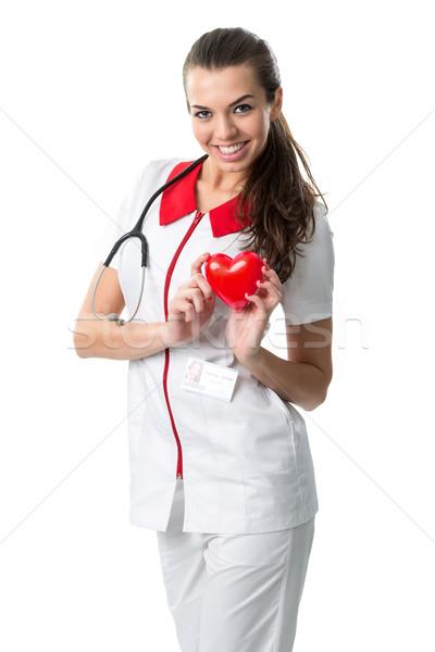 Piękna pielęgniarki sukienka czerwony serca Zdjęcia stock © Geribody