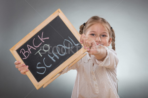 Beautiful little girl holding board on Back To School subtitles  Stock photo © Geribody