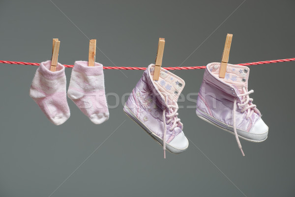 baby girl shoes and socks on the clothesline Stock photo © Geribody