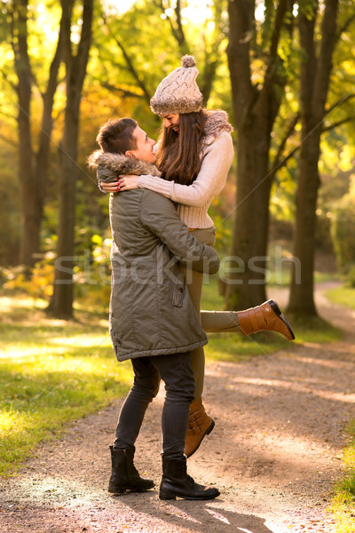 In love with a man, pick up a woman on his lap Stock photo © Geribody