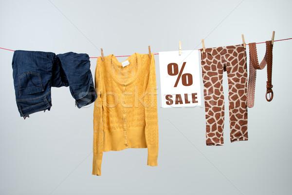 Women's fashion discount on the clothesline Stock photo © Geribody