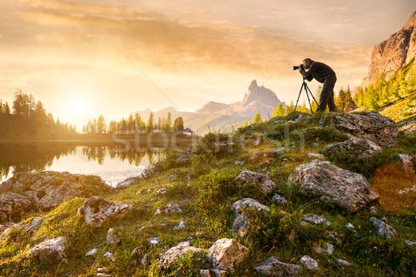 A photographer in the beautiful lake Federa Stock photo © Geribody