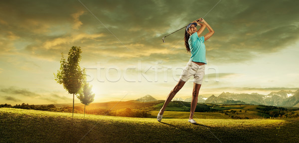 Woman golfer hitting the ball on the background scenery  beautiful Stock photo © Geribody