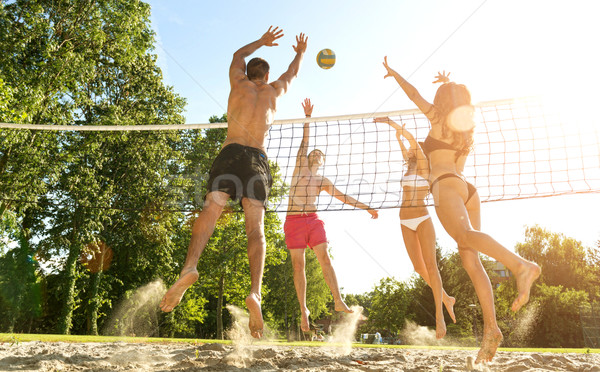 Group young  Friends Playing Volleyball On Beach Stock photo © Geribody