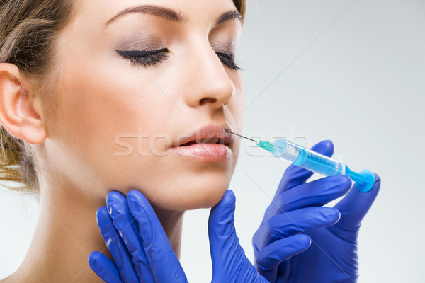 Beautiful woman with lip surgery Stock photo © Geribody