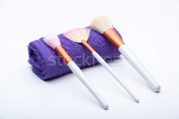 Makeup Brushes on purple towel Stock photo © Geribody
