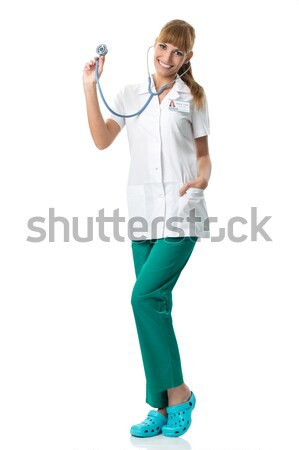Smiling Doctor in white medical gown ,showing stetoscope Stock photo © Geribody