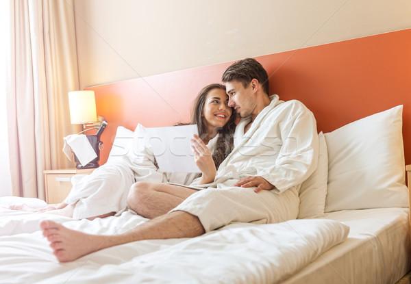Fiatal pér ágy hotelszoba férfi pár szoba Stock fotó © Geribody
