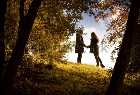 Lovers holding hands walking in the autumn park Stock photo © Geribody