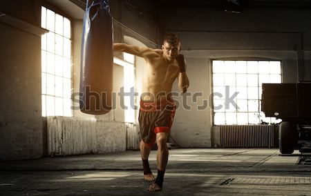 Stock photo: Young woman boxing workout in an old building