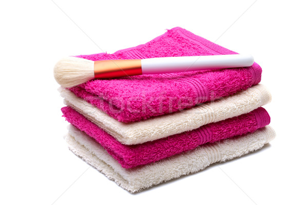 Brushes for make-up , on pink, white towel  Stock photo © Geribody