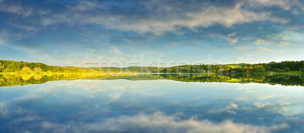 Beautiful yellow rape field, reflected in the lake, Stock photo © Geribody