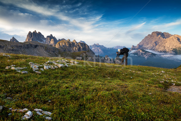 Italy, Dolomites - Men hiker photographers make the best pictures at dawn  Stock photo © Geribody