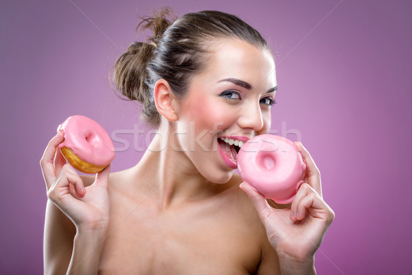 Beautiful woman with two donuts. You may eat or not? Stock photo © Geribody
