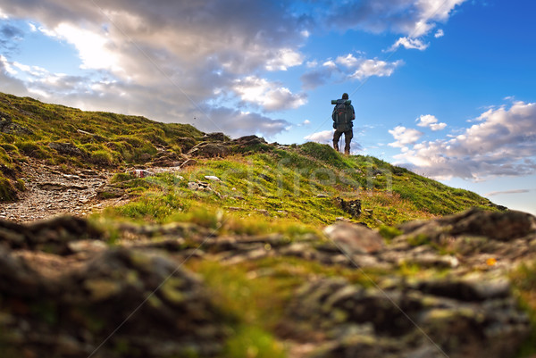 Male hiker standing in high peak Stock photo © Geribody