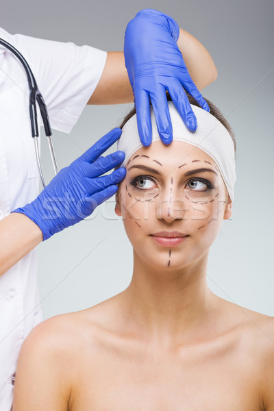 Beautiful woman with plastic surgery, drawn, plastic surgeon hands  Stock photo © Geribody