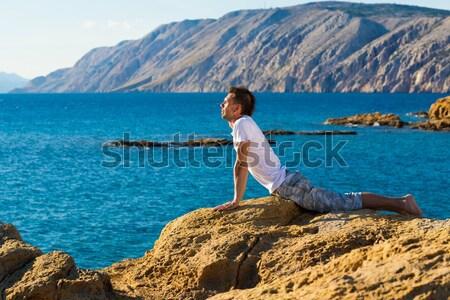 Güzel bir kadın yoga meditasyon plaj seksi genç kadın Stok fotoğraf © Geribody