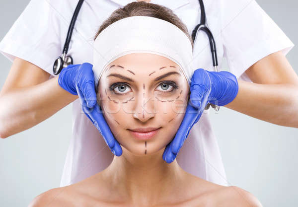 Plastic surgery - Beautiful woman face, with surgical markings  Stock photo © Geribody