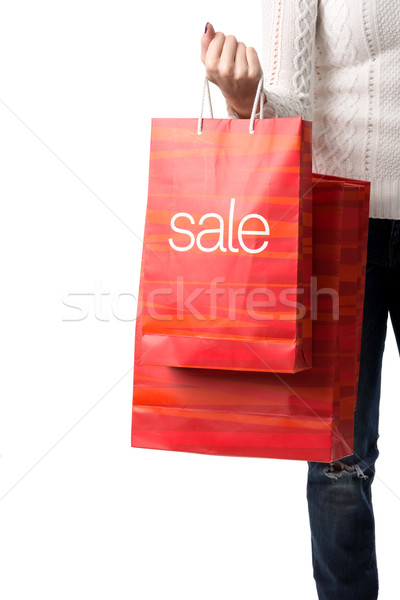 SALE, detail photo of a woman holding the hands of sale bags Stock photo © Geribody