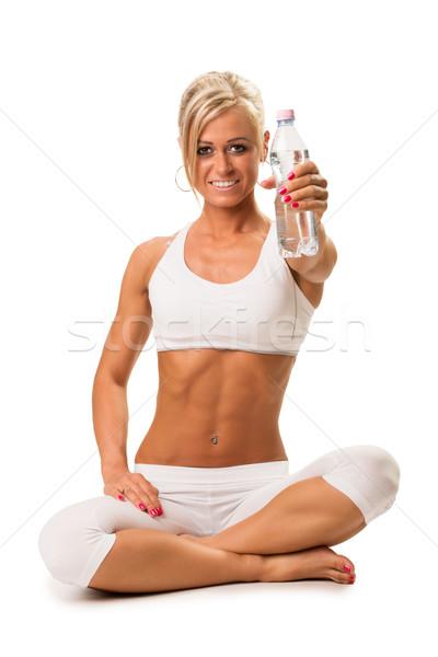Geschikt glimlachend blond vrouw mineraalwater Stockfoto © Geribody
