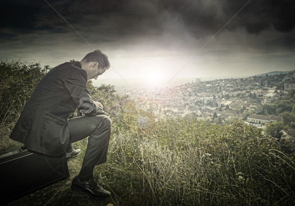 Sad, lonely businessman on the hillside Stock photo © Geribody