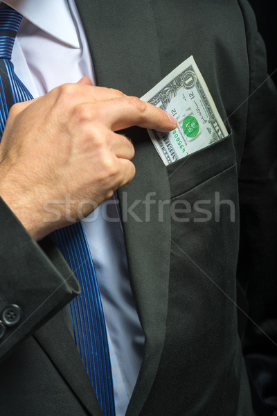 Businessman pulling their money out of pocket Stock photo © Geribody