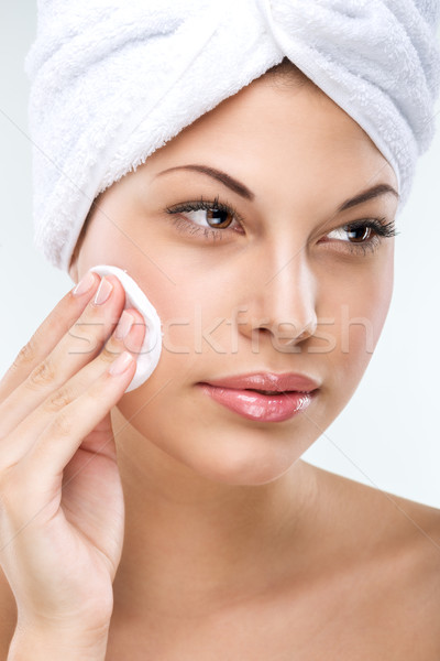 Beautiful woman with flawless skin, cleansing Stock photo © Geribody