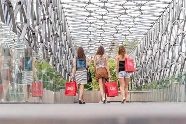 3 Pretty woman walking on the bridge, they go shopping - back photo  Stock photo © Geribody
