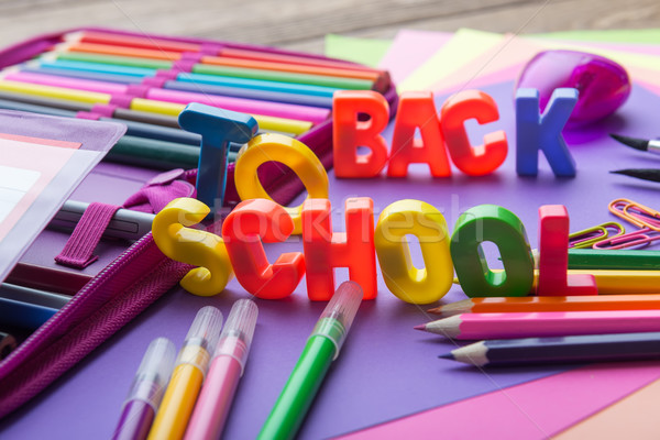 Many school stationery in a heap in the middle of Back to School subtitles Stock photo © Geribody