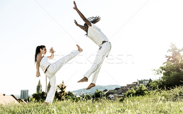 Pair of capoeira performers doing a kicking Stock photo © Geribody