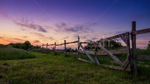 Beautiful blue-colored landscape, old wooden fence in the foreground Stock photo © Geribody