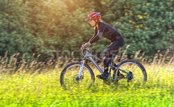 Stock photo: Sport bike woman in a beautiful meadow